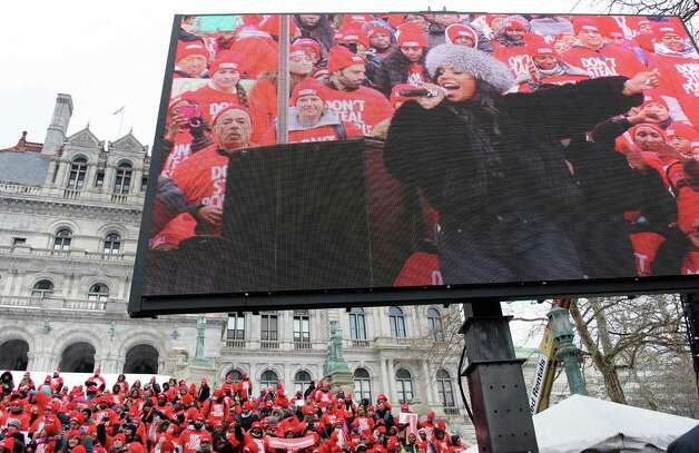 A large video screen shows singer Ashanti as she performs during a pro-charter school rally at the Capitol Wednesday, March 4, 2015, in Albany, NY.  (John Carl D'Annibale / Times Union) Photo: John Carl D'Annibale / 00030815A