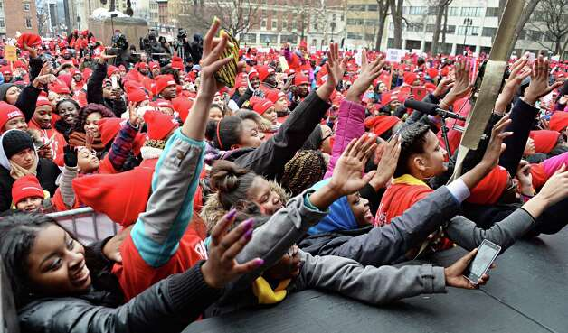 Fans reach up onto the stage as singer Ashanti performs at a pro-charter school rally at the Capitol Wednesday, March 4, 2015, in Albany, NY.  (John Carl D'Annibale / Times Union) Photo: John Carl D'Annibale / 00030815A
