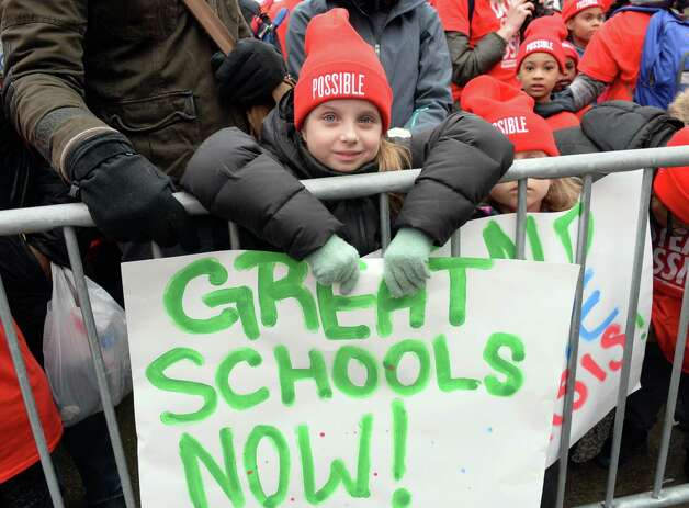 Nine-year-old Bella Paraschac of Manhattan holds a sign during a pro-charter school rally at the Capitol Wednesday, March 4, 2015, in Albany, NY.  (John Carl D'Annibale / Times Union) Photo: John Carl D'Annibale / 00030815A