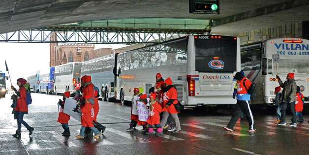 Children are lead from buses on Madison Ave. on their way to the pro-charter school rally at the Capitol Wednesday March 4, 2015 in Albany, NY.  (John Carl D'Annibale / Times Union) Photo: John Carl D'Annibale / 00030815A