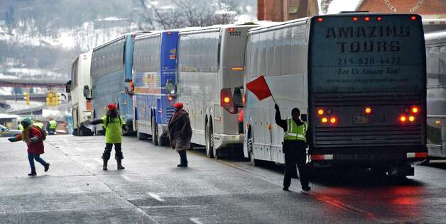 Buses queue up on Madison Ave. bringing student, parents and educators to the pro-charter school rally at the Capitol Wednesday March 4, 2015 in Albany, NY.  (John Carl D'Annibale / Times Union) Photo: John Carl D'Annibale / 00030815A