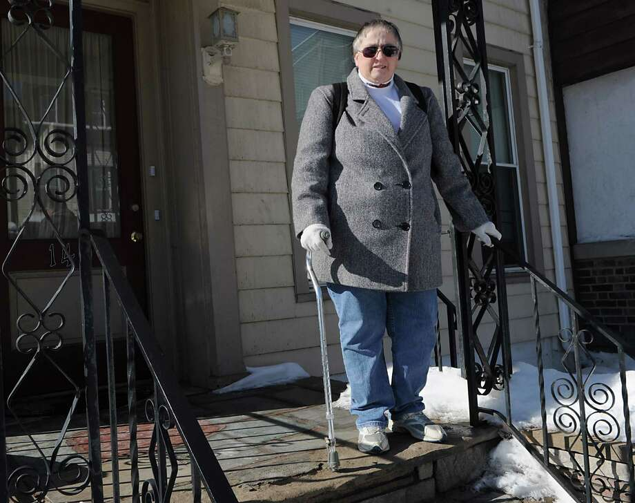Candace Woodard stands outside her home on Friday, Feb. 13, 2015 in Cohoes, N.Y. Woodard is having trouble getting her own medical records from her doctor. She has a lot of information she is trying to pull together for a disability case. (Lori Van Buren / Times Union) Photo: Lori Van Buren / 00030607A