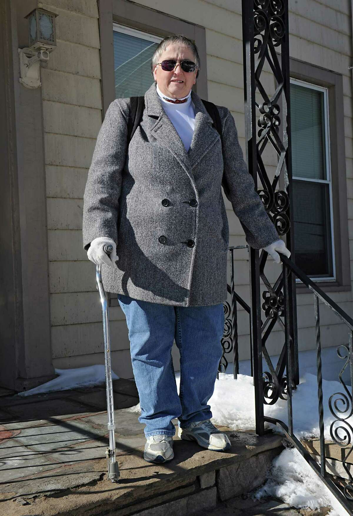 Candace Woodard stands outside her home on Friday, Feb. 13, 2015 in Cohoes, N.Y. Woodard is having trouble getting her own medical records from her doctor. She has a lot of information she is trying to pull together for a disability case. (Lori Van Buren / Times Union)