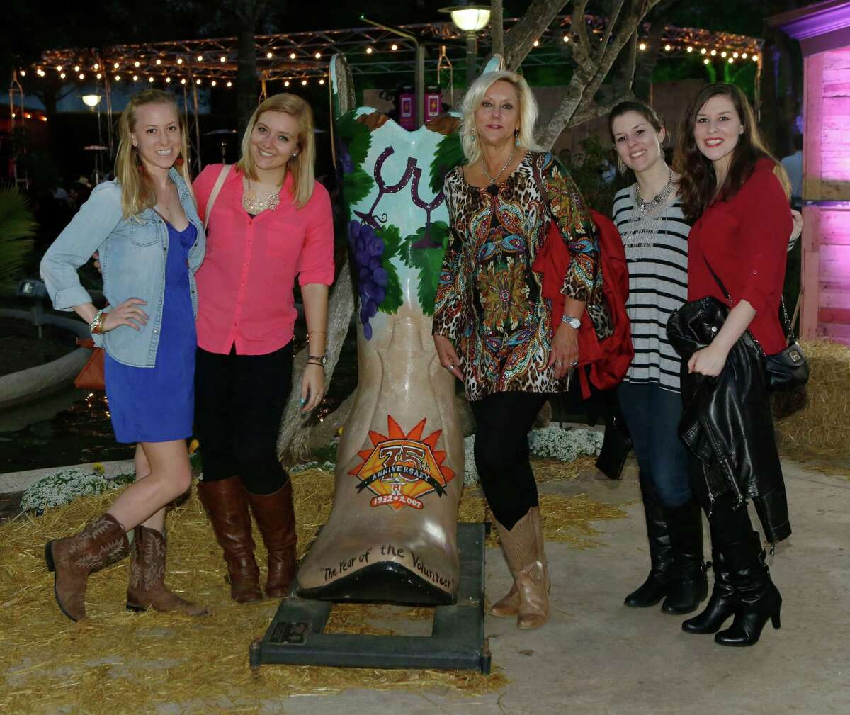 Guests pose for a photo before the Hunter Hayes concert at the Houston Livestock Show and Rodeo Wednesday, March 4, 2015, in Houston.