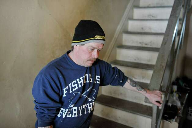 Eric Daus stands inside his mother's home on Fourth Ave., where he also lives, on Wednesday, March 4, 2015, in Troy, N.Y.  The water pipe leading into the home has frozen and the city says that it is the homeowners responsibility to hire someone to fix the problem.  (Paul Buckowski / Times Union) Photo: PAUL BUCKOWSKI / 10030855A