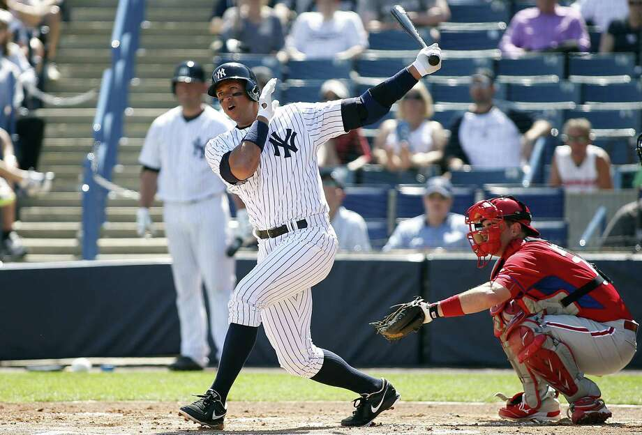 TAMPA, FL - MARCH 4:  Designated hitter Alex Rodriguez #13 of the New York Yankees follows through as he hits a single to left field in front of catcher Tommy Joseph #73 of the Philadelphia Phillies during the first inning of a spring training game on March 4, 2015 at Steinbrenner Field in Tampa, Florida.  (Photo by Brian Blanco/Getty Images) *** BESTPIX *** ORG XMIT: 536925589 Photo: Brian Blanco / 2015 Getty Images