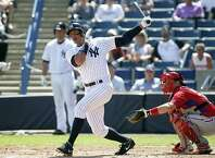 TAMPA, FL - MARCH 4:  Designated hitter Alex Rodriguez #13 of the New York Yankees follows through as he hits a single to left field in front of catcher Tommy Joseph #73 of the Philadelphia Phillies during the first inning of a spring training game on March 4, 2015 at Steinbrenner Field in Tampa, Florida.  (Photo by Brian Blanco/Getty Images) *** BESTPIX *** ORG XMIT: 536925589