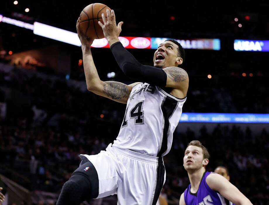 The Kings' Nik Stauskas fouls the Spurs' Danny Green on his drive to the basket during the first half of Wednesday's game at the AT&T Center. Photo: Kin Man Hui /San Antonio Express-News / ©2015 San Antonio Express-News