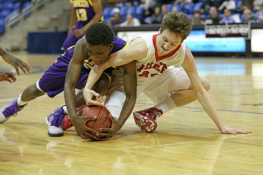 Fairfield Prep's #21 Ryan Foley battles for a loose ball against Career High School's #5 Tyquis Burney McKeithen during Wednesday SCC boys championship game. Career wuld win  81-59. Photo: Mike Ross / Mike Ross Connecticut Post freelance -www.mikerossphoto.com