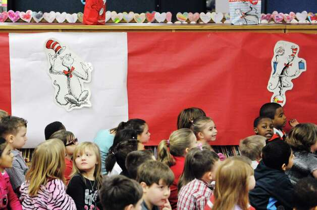 Children listen as a Dr. Seuss book is read to them during World Read Aloud Day at Turnpike Elementary School on Wednesday, March 4, 2015, in Lansingburgh, N.Y.  World Read Aloud Day is held to promote literacy worldwide.  (Paul Buckowski / Times Union) Photo: PAUL BUCKOWSKI / 10030852A