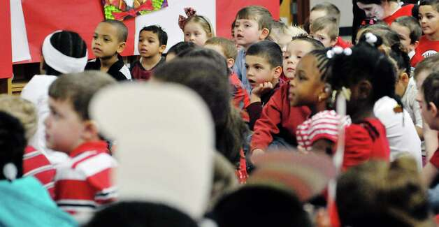 Children listen as a Dr. Seuss book is read to them during World Read Aloud Day at Turnpike Elementary School on Wednesday, March 4, 2015, in Lansingburgh, N.Y. (Paul Buckowski / Times Union) Photo: PAUL BUCKOWSKI / 10030852A