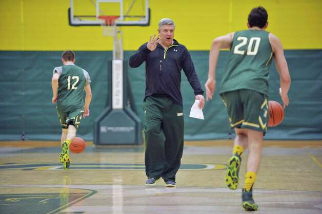 Siena head coach, Jimmy Patsos, works with his players during Siena men's basketball practice at the college on Wednesday, March 4, 2015, in Loudonville, N.Y.   (Paul Buckowski / Times Union) Photo: PAUL BUCKOWSKI / 10030860A