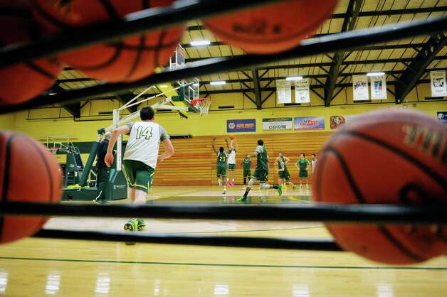 Siena men's basketball players run through drills during practice at the college on Wednesday, March 4, 2015, in Loudonville, N.Y.   (Paul Buckowski / Times Union) Photo: PAUL BUCKOWSKI / 10030860A