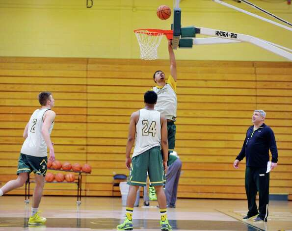Javion Ogunyemi puts up a shot during Siena men's basketball practice at the college on Wednesday, March 4, 2015, in Loudonville, N.Y.   (Paul Buckowski / Times Union) Photo: PAUL BUCKOWSKI / 10030860A
