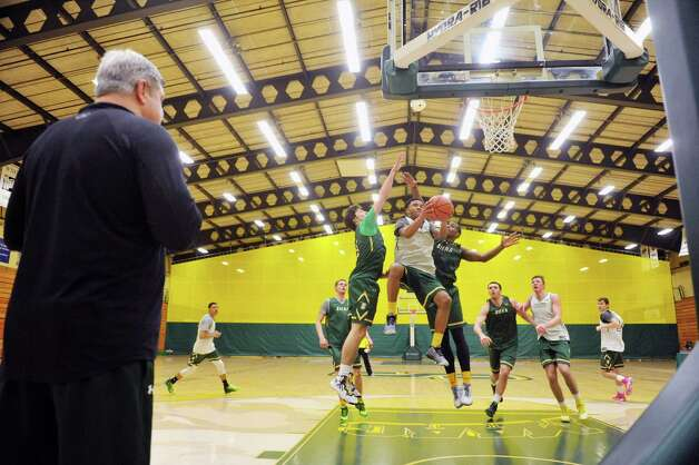 Siena head coach Jimmy Patsos, left, watches as his players scrimmage during Siena men's basketball practice at the college on Wednesday, March 4, 2015, in Loudonville, N.Y.   (Paul Buckowski / Times Union) Photo: PAUL BUCKOWSKI / 10030860A