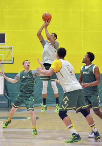 Ryan Oliver puts up a shot during Siena men's basketball practice at the college on Wednesday, March 4, 2015, in Loudonville, N.Y.   (Paul Buckowski / Times Union) Photo: PAUL BUCKOWSKI / 10030860A