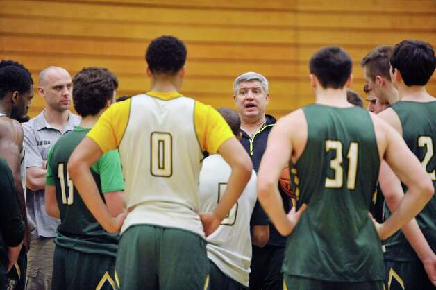 Siena head coach Jimmy Patsos, center, talks to his players during Siena men's basketball practice at the college on Wednesday, March 4, 2015, in Loudonville, N.Y.   (Paul Buckowski / Times Union) Photo: PAUL BUCKOWSKI / 10030860A