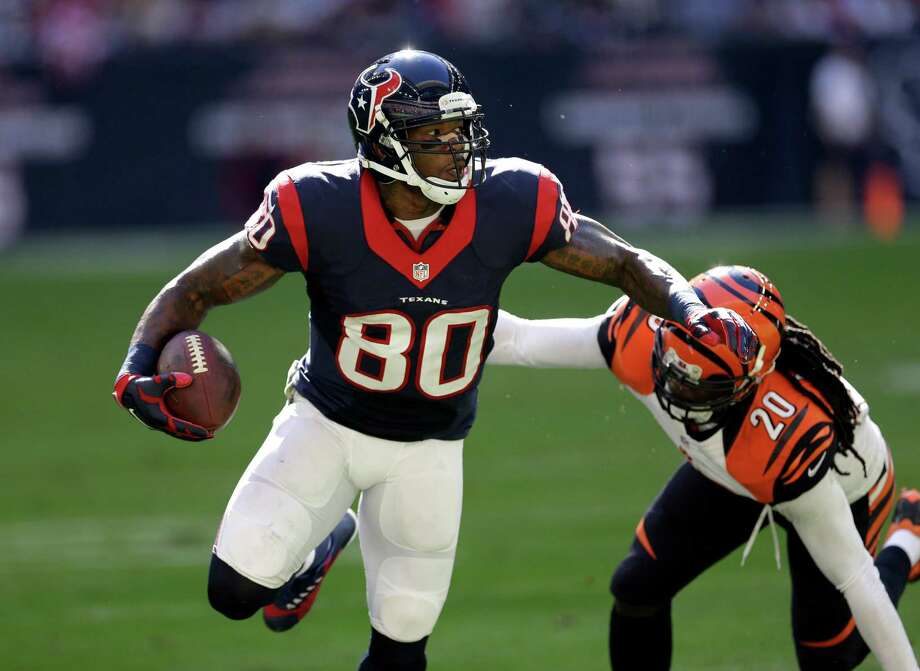 Houston Texans wide receiver Andre Johnson catches a pass as Cincinnati Bengals free safety Reggie Nelson defends during the second quarter on Nov. 23, 2014, in Houston. Photo: David J. Phillip /Associated Press / AP