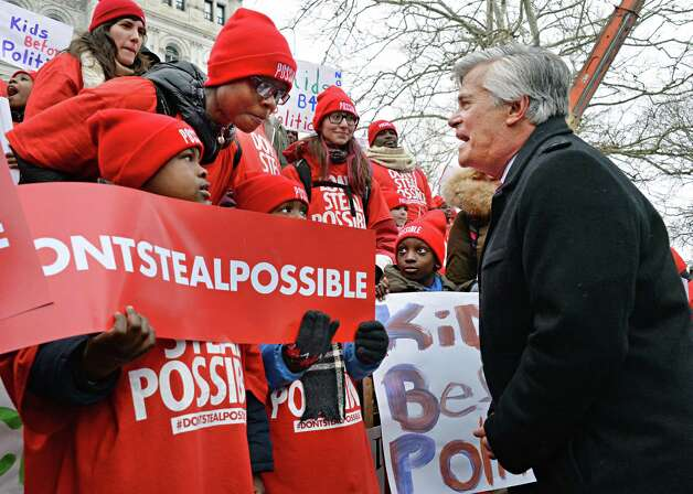 Senate Majority Leader Dean Skelos, right, speaks with school children during a pro-charter schools rally at the Capitol Wednesday, March 4, 2015, in Albany, N.Y.  (John Carl D'Annibale / Times Union) Photo: John Carl D'Annibale / 00030815A
