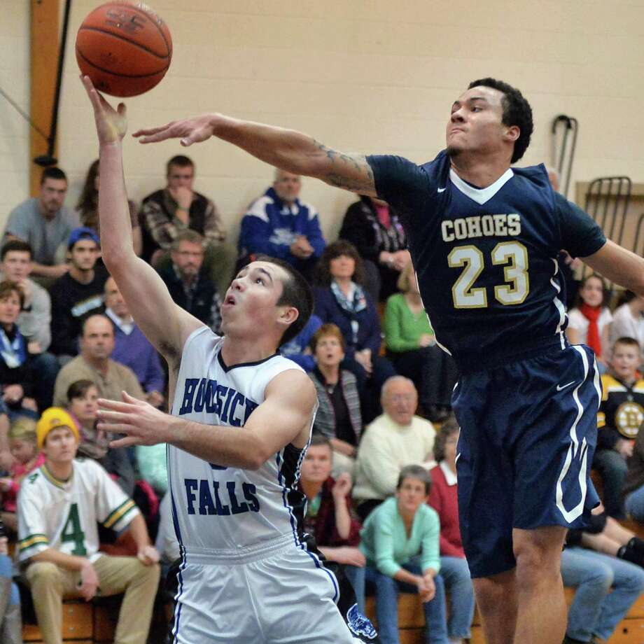 Hoosick Falls's #5 Andrew Hoag, left, goes to the basket guarded by Cohoes' #23 Shelton Alston during Saturday's game Jan. 17, 2015, in Hoosick Falls, NY.  (John Carl D'Annibale / Times Union) Photo: John Carl D'Annibale / 00030215A