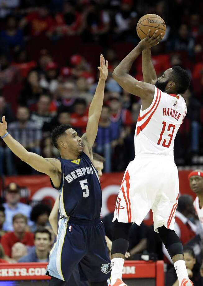 James Harden, who was held to 18 points, rises over the Grizzlies' Courtney Lee. Photo: Pat Sullivan, STF / AP