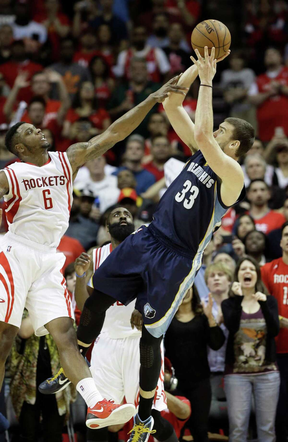 Marc Gasol (33) gives the Grizzlies the game-winner with a 10-footer over the Rockets' Terrence Jones with 0.1 seconds remaining Wednesday night at Toyota Center.