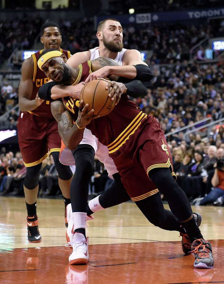 Cleveland Cavaliers' LeBron James (23) is fouled Toronto Raptors' Jonas Valanciunas during the second half of an NBA basketball game Wednesday, March 4, 2015, in Toronto. (AP Photo/The Canadian Press, Frank Gunn) Photo: Frank Gunn, SUB / The Canadian Press