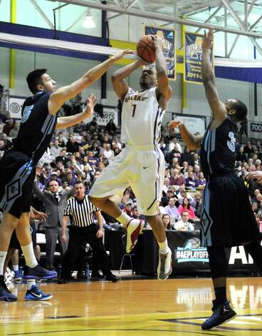 UAlbany's Ray Sanders drives to the basket during their America East quarterfinals game against Maine at the SEFCU Arena on Wednesday March 4, 2015 in Albany, N.Y.  (Michael P. Farrell/Times Union) Photo: Michael P. Farrell / 00030745A