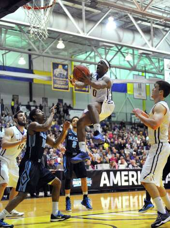 UAlbany's Evan Singletary goes in for a score during their America East quarterfinals game against Maine at the SEFCU Arena on Wednesday March 4, 2015 in Albany, N.Y.  (Michael P. Farrell/Times Union) Photo: Michael P. Farrell / 00030745A