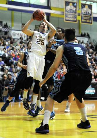 UAlbany's Wheeler Baker drives to the basket during their America East quarterfinals game against Maine at the SEFCU Arena on Wednesday March 4, 2015 in Albany, N.Y.  (Michael P. Farrell/Times Union) Photo: Michael P. Farrell / 00030745A