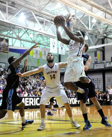 UAlbany's Evan Singletary drives to the basket during their America East quarterfinals game against Maine at the SEFCU Arena on Wednesday March 4, 2015 in Albany, N.Y.  (Michael P. Farrell/Times Union) Photo: Michael P. Farrell / 00030745A