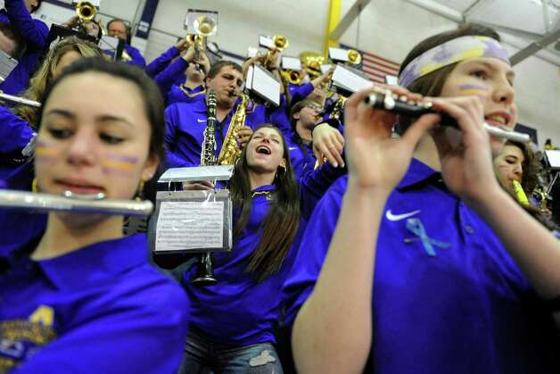 UAlbany Pep band clarinetist Tessa Schaal, center, takes a dance break as she and bandmates play during their America East quarterfinals game against Maine at the SEFCU Arena on Wednesday March 4, 2015 in Albany, N.Y.  (Michael P. Farrell/Times Union) Photo: Michael P. Farrell / 00030745A