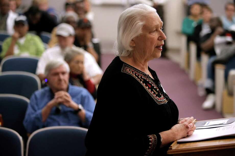 Jim Mallory, (left seated) listens to public comments by his wife, Roseanne Allen, to the West Contra Costa Healthcare District Board of Directors during a meeting at Doctors Medical Center on Wednesday in San Pablo. Photo: Michael Macor / The Chronicle / ONLINE_YES
