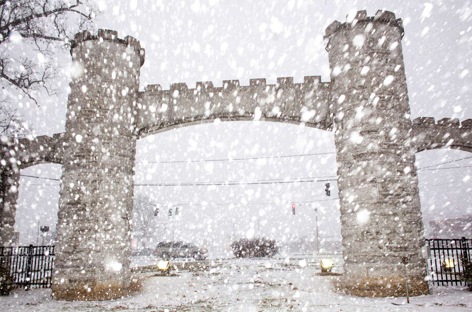 Snow falls near the entrance of Noble Park, Wednesday, March 4, 2015, in Paducah, Ky. A storm stretching from northern Texas to southern New England is set to bring what could be winter's last significant snowfall for the East Coast. Photo: John Paul Henry, AP / The Paducah Sun