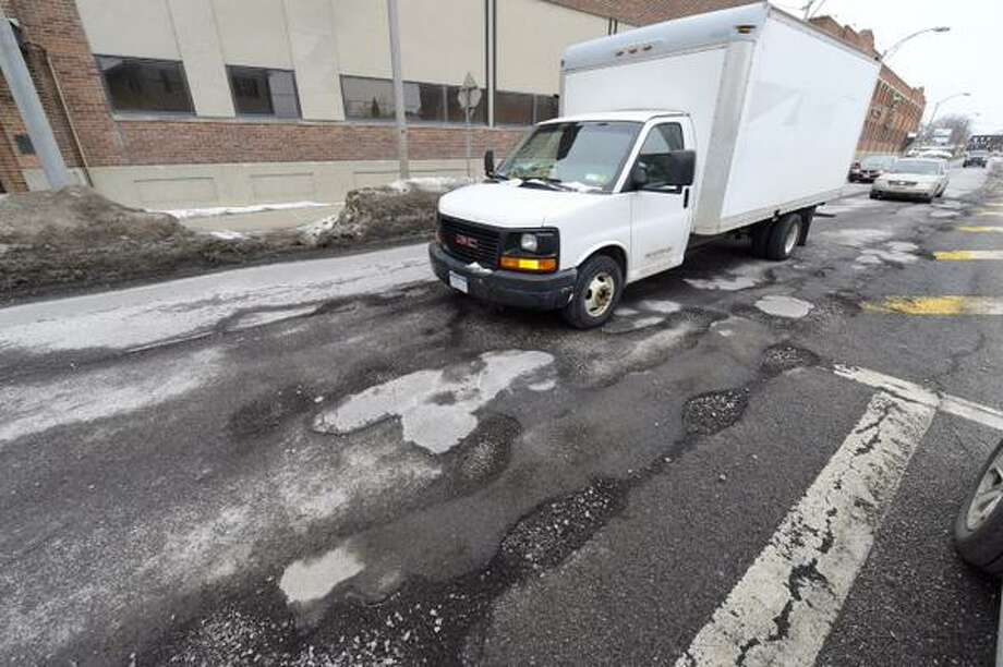 Potholes on Erie Boulevard in Schenectady are large to force this truck to slow down. City highway workers will be patching potholes on Thursday. (Skip Dickstein / Times Union)