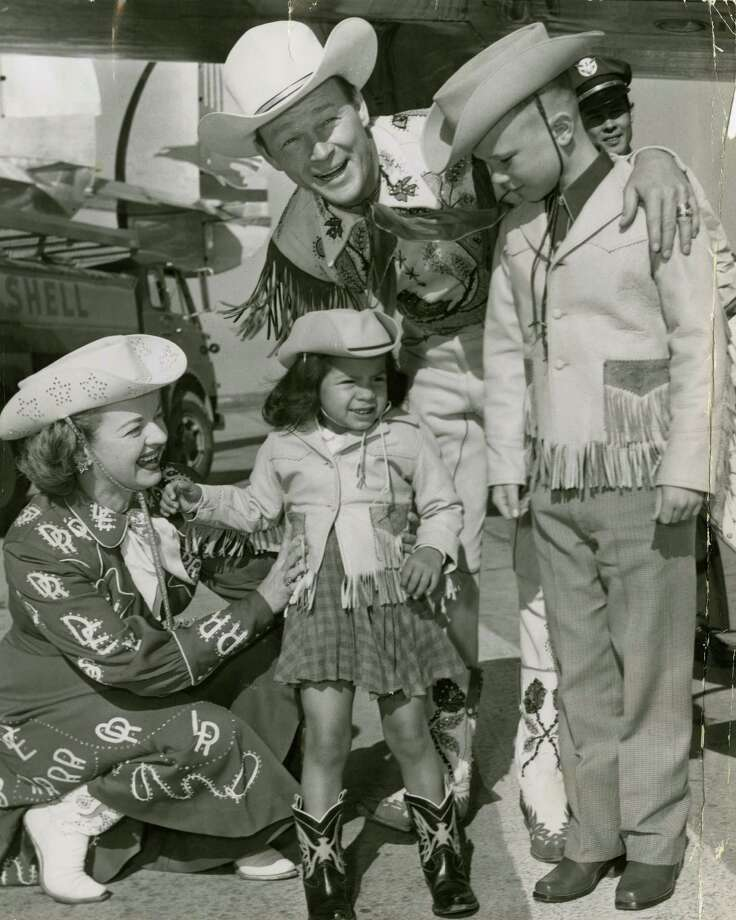 It's a tradition for entertainers to dress in western wear at the rodeo. Dale Evans and Roy Rogers with two of their children  for the 1956 Houston Fat Stock Show and Rodeo Photo: Bob Verlin, HP Staff / Houston Post files