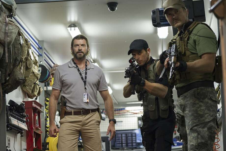 "Special citation for a too-good action movie: ""Chappie."" Photo: Stephanie Blomkamp, Associated Press"