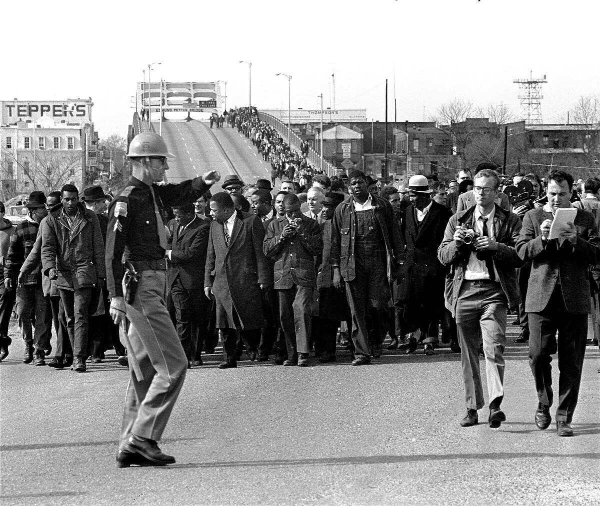 Martin Luther King, Jr., and his demonstrators stream over an Alabama River bridge at the city limits of Selma, Ala., March 10, 1965, during a voter rights march. They were stopped and turned back a short time later. A federal judge had banned the march.