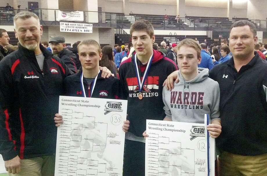 Charlie Kane and brother Tim pose with their championship brackets after winning the 138-pound class and the 126-pound class, respectively, at the recent State Open wrestling meet. From left: Warde assistant coach Bob Gillen, Charlie Kane, Dan Ebert, who finished third in the 145-pound class, Tim Kane and Warde head coach Jason Shaughnessy. Photo: Contributed, Contributed Photo / Fairfield Citizen
