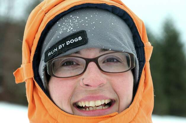 Saint Gregory's School first graders got a ride on a dog sled driven by musher Kate Walrath on Thursday March 5, 2015, at Saint Gregory's School in Loudonville, N.Y. Walrath runs a pet service called Run By Dogs, which offers sled dog excursions and educational programs. Saint Gregory?s classes will follow the progress of this year?s Iditarod race. The Kindergarten has prepared a map to help students track the race. The activities are design to help pupils learn about Alaska, and to experience how difficult the event is. (Michael P. Farrell/Times Union) Photo: Michael P. Farrell / 10030850A