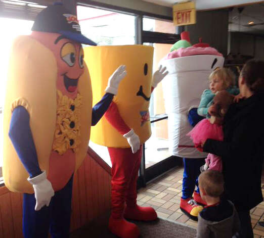 Abigail Bartholomew of Wilton gets a look at Sonic's mascots during announcement of their new Colonie location Thursday. (John Carl D'Annibale/Times Union)