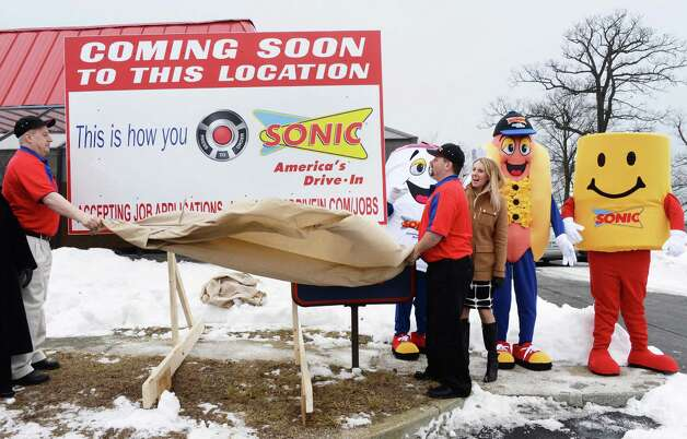 Sonics employees and mascots unveil sign for new Sonic Drive-In coming to the former King Buffet site on Troy Schenectady Road Thursday March 5, 2015 in Colonie, NY.  (John Carl D'Annibale / Times Union) Photo: John Carl D'Annibale / 10030863A