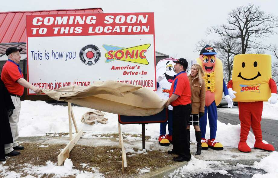 Sonic employees and mascots unveil sign for new Sonic Drive-In coming to the former King Buffet site on Troy Schenectady Road Thursday, March 5, 2015, in Colonie, NY.  (John Carl D'Annibale / Times Union) Photo: John Carl D'Annibale / 10030863A