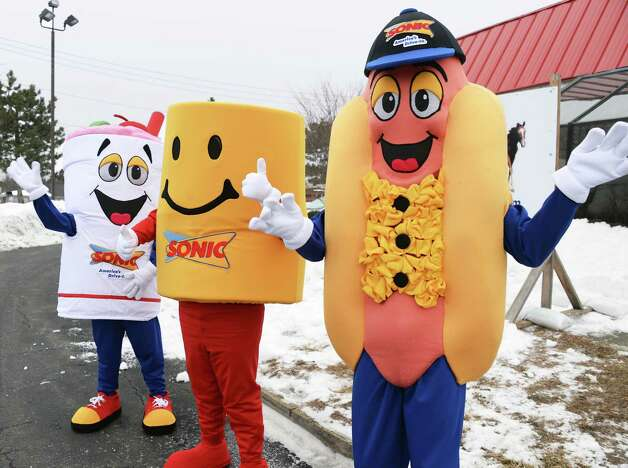 Sonics mascots wave to motorists at new Sonic Drive-In site on Troy Schenectady Road Thursday March 5, 2015 in Colonie, NY.  (John Carl D'Annibale / Times Union) Photo: John Carl D'Annibale / 10030863A