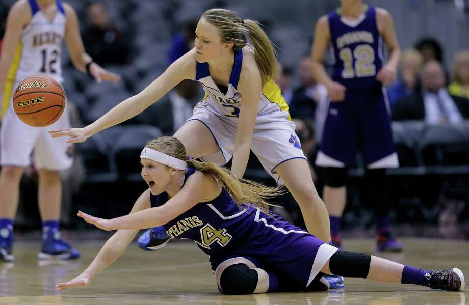 D'Hanis High School's Mallory McCollum (24) and Nazareth High School's Abby Schumucker (3) chase a loose ball during the first half of a UIL Girls 1A Basketball State semifinal game, Thursday, March 5, 2015, in San Antonio. Nazareth won 61-18. (AP Photo/Eric Gay) Photo: Eric Gay, STF / Associated Press / AP