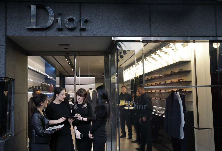 Allison Speer, second from right, discusses the evening's events with her staff, Hana Dahi, left, Sarah Lemp, second from left, and Ching Nola, right, during the Dior Homme celebration of the Mid-Winter Gala at the Dior Homme Boutique in San Francisco, Calif., on Wednesday, March 4, 2015. Public relations specialist Allison Speer has become the go-to professional for luxury retail PR and events in San Francisco. Photo: Carlos Avila Gonzalez, The Chronicle