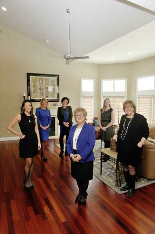 Founding partners of Peak Residential Partners, from left to right, Farrin Wagoner, Leah Slocum, Ann Manning, Ro Mosmen, Judi Gabler and Sandy LaValle pose for a photograph inside a home at 22 Windsor Court, on Tuesday, March 3, 2015, in Slingerlands, N.Y.  The home is on the market for $709,000.   (Paul Buckowski / Times Union) Photo: PAUL BUCKOWSKI / 00030835A