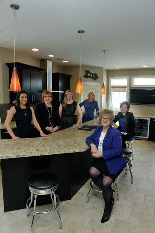Founding partners of Peak Residential Partners, from left to right, Farrin Wagoner, Sandy LaValle, Judi Gabler, Leah Slocum, Ro Mosmen and Ann Manning pose for a photograph in the kitchen of a home at 22 Windsor Court, on Tuesday, March 3, 2015, in Slingerlands, N.Y.  The home is on the market for $709,000.   (Paul Buckowski / Times Union) Photo: PAUL BUCKOWSKI / 00030835A