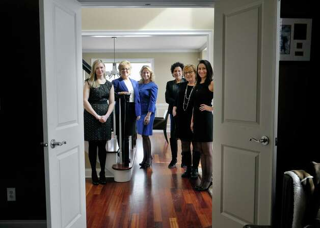 Founding partners of Peak Residential Partners, from left to right, Judi Gabler, Ro Mosmen, Leah Slocum, Ann Manning, Sandy LaValle and Farrin Wagoner pose for a photograph inside a home at 22 Windsor Court, on Tuesday, March 3, 2015, in Slingerlands, N.Y.  The home is on the market for $709,000.   (Paul Buckowski / Times Union) Photo: PAUL BUCKOWSKI / 00030835A