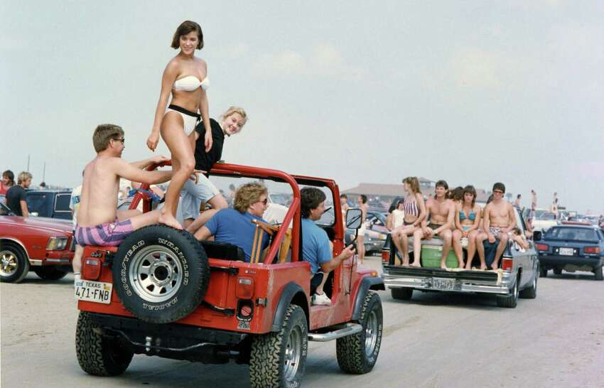 Check out Spring break through the 80s and 90sRiding on top of Jeep is Colleen McCormack of Lee High School in Houston. Thousands of students spent Saturday at Galveston's East Beach. Jeep s driver is Bill Moore. March 13, 1988.